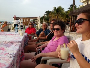 "Sharing ""big fish"" tales at sunset - Playa Norte, Isla Mujeres."