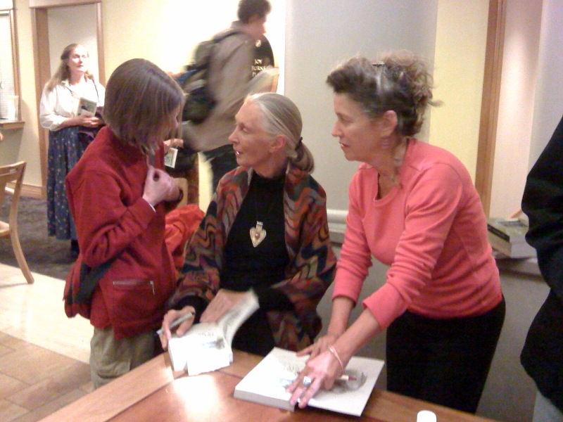 Jane Goodall autographs books after the awards ceremony