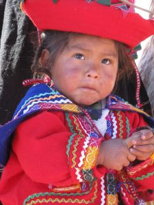 peruvian girl in the sacred valley during andes eco tour